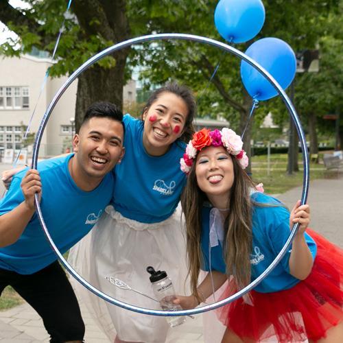 Spark Spirit Leaders pose inside a hula hoop